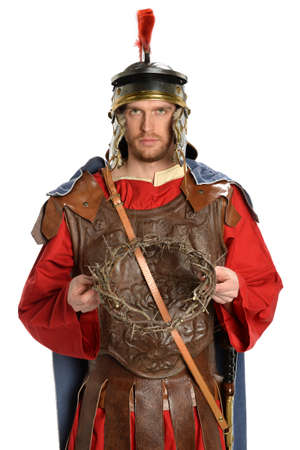 Portrait of Roman soldier holding crown of thorns isolated over white background Stock Photo