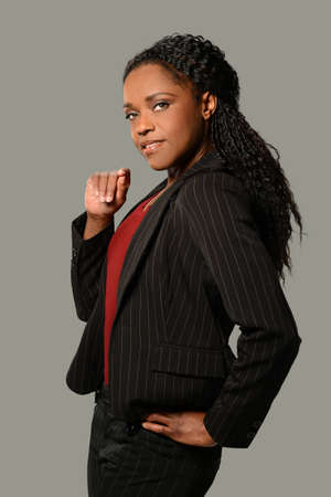 businesswoman suit: African American businesswoman isolated over gray background