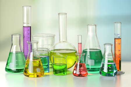 yellow lab: Laboratory glassware on white table and window in background - With Clipping Path on glassware