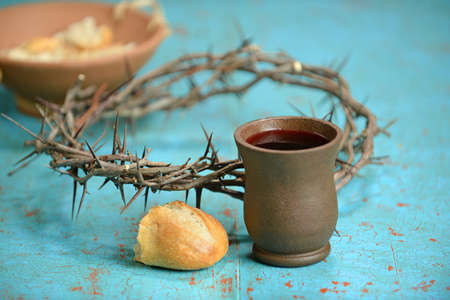 supper: Communion elements with wine; bread and crown of thorns on old table
