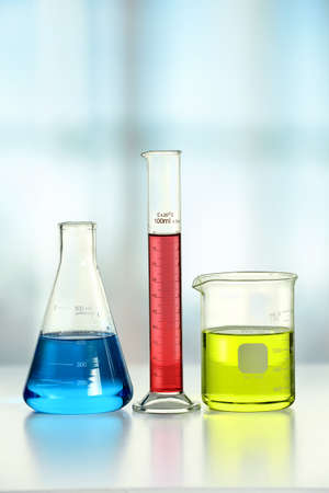 volumetric flask: Laboratory glassware on white table and window in background Stock Photo