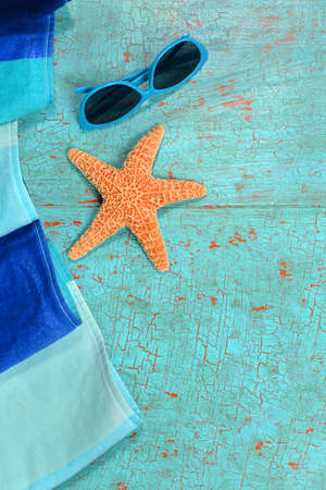 beach towel: Summer concept with beach towel, starfish and sunglasses on grunge table Stock Photo