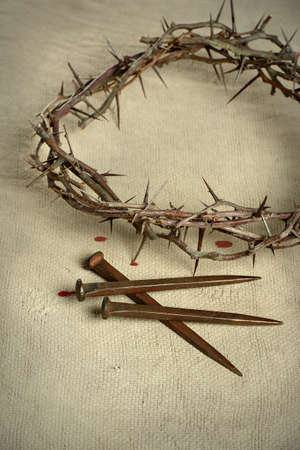 jesus christ crown of thorns: Crown of thorns and nails over vintage cloth Stock Photo