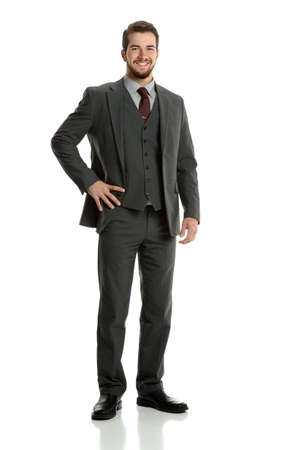 Portrait of young businessman standing isolated over white background Stock Photo