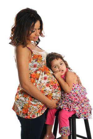 hispanic woman: Portrait of pregnant Hispanic mother and daughter isolated over white background