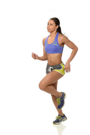woman running: Young African American woman running isolated over white background Stock Photo