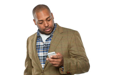young men: Young African American businessman using cellphone isolated over white background Stock Photo