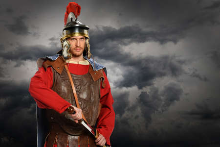 roman: Portrait of Roman soldier with sword 0ver stormy sky