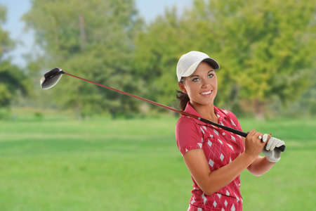 woman golf: Beautiful young woman playing golf on the course