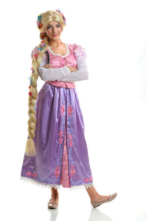 rapunzel: BEautiful young woman dressed in princes costume isolated over white background