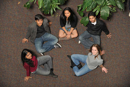 ethnically diverse: Ethnically diverse group of students sitting on floor Stock Photo