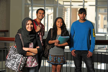 diverse: Group of diverse students inside school environment