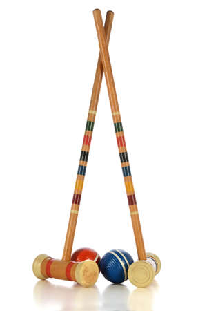 MAllets and balls of croquet game isolated over white background - With clipping path