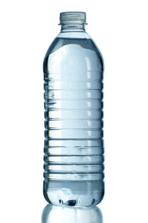 Bottled water with reflection on table isolated over white background - With clipping path on bottle Archivio Fotografico