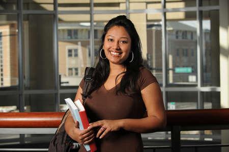 campus building: Ethnic female student inside campus building