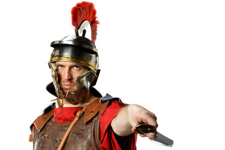 Roman soldier brandishing sword isolated over white background Stock Photo
