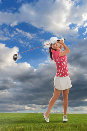 woman golf: Beautiful young woman playing golf during bright day