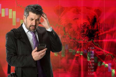 market crash: Business concept representing stock market crash with businessman getting bad news Stock Photo