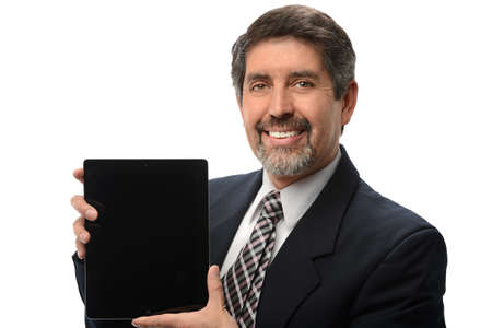 electronic tablet: Hispanic businessman using electronic tablet isolated over white background