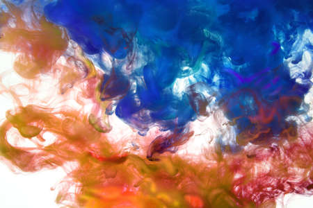 Inks of different colors dissolving in water Stock Photo