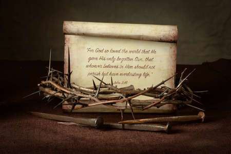 scripture: Bible Scripture with crown of thorns and nails over cloth - John 3:16 Stock Photo
