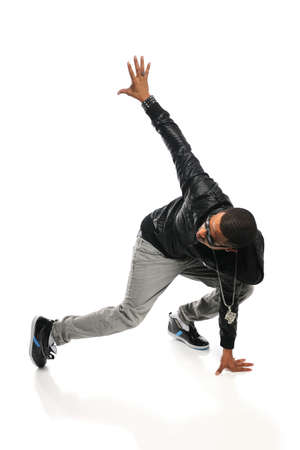 African American hip hop dancer performing isolated over white background photo