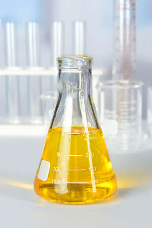 colorant: Beaker with yellow colorant on laboratory table