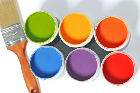 primary colors: Cans of different colors and paintbrush over light background Stock Photo