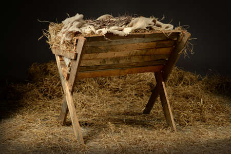 Manger with crown of thorns in barn. Concept based on the birth and death of Jesus.