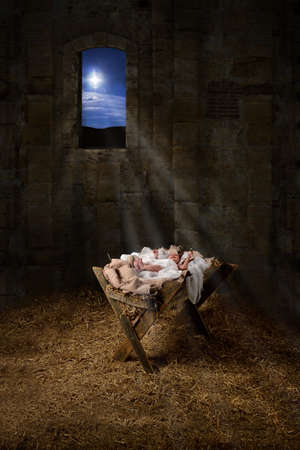 Baby Jesus resting on a manger with light from the star filters through window