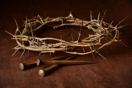 Crown of thorns and nails over vintage cloth Stock Photo