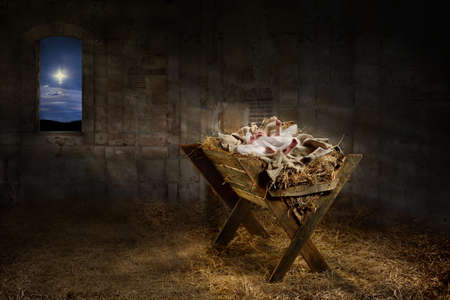 birth of christ: Jesus resting on a manger while light from the star filters into the room