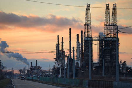 industrial district: Industrial district with oil refinery at sunset