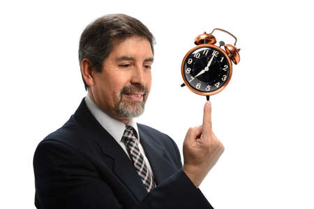 Portrait of Hispanic businessman balancing vintage clock isolated over white background