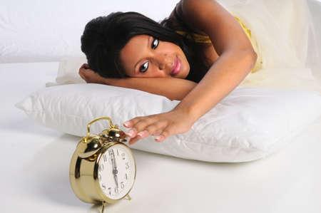 african american woman: African American woman silencing alarm clock