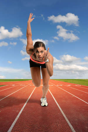 african american woman: Young African American woman running on track