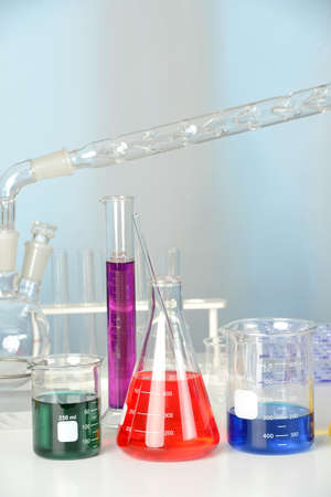 distillation: Laboratory glassware on table with flasks and beakers and distillation set
