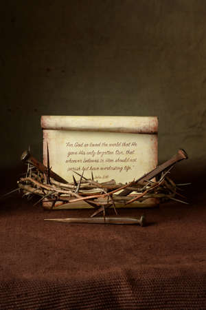 Crown of thorns and nails with John 3:16 verse over cloth Stock Photo - 63777344