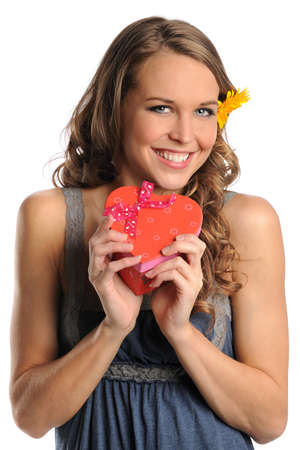 Portrait of beautiful young woman holding red heart gift box isolated over white background photo