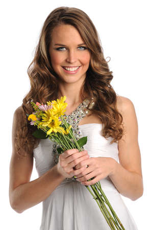 Portrait of beautiful young woman holding flowers isolated over white background photo