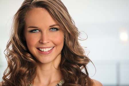Portrait of beautiful businesswoman smiling inside office complex photo