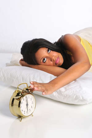 african american woman: Young African American woman silencing alarm clock