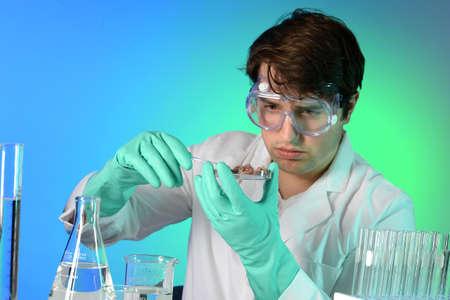 e coli: Young scientist testing meat on petri dish in laboratory Stock Photo