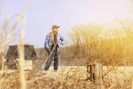 outdoorsman: Mature Hispanic man enjoying the outdoors at sunset