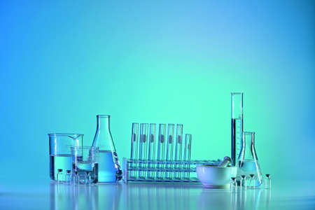 Laboratory glassware on table with colored background 版權商用圖片