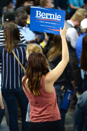Saint Charles, MO, USA - March 14, 2016: Supporter holds sign during Bernie Sanders campaign rally at the Family Arena in Saint Charles, Missouri.