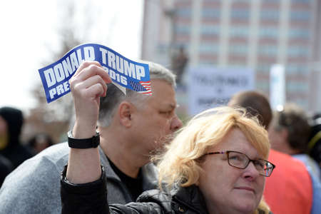 Saint Louis, MO, USA - March 11, 2016: Donald Trump supporter holds sticker outside the Peabody Opera House in Downtown Saint Louis