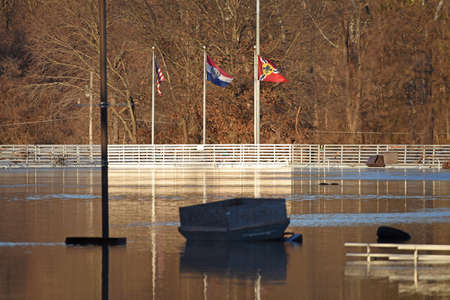 VALLEY PARK, MO/USA - JANUARY 1, 2016: Flood waters near the Meramec River flood nearby park in old town Fenton. Sajtókép