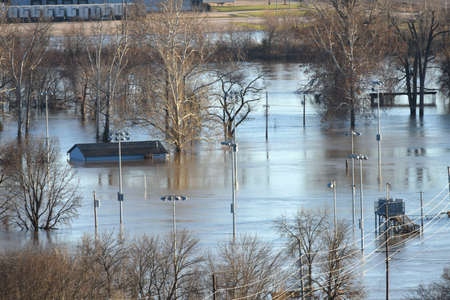 submerge: VALLEY PARK, MOUSA - JANUARY 1, 2016: Flood waters nearly submerge house in Valley Park in old town Fenton.