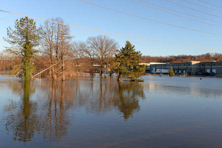 VALLEY PARK, MOUSA - JANUARY 1, 2016: Flood waters near the Meramec River flood car and road signs in Valley Park, Missouri